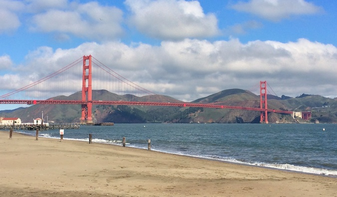 Looking up at the Golden Gate Bridge from the San Francisco Beach in the summer