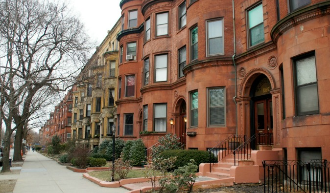 Red townhouses in Boston back bay neighborhood