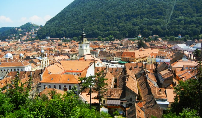 The charming city of Brasov, surrounded by green forests and mountains