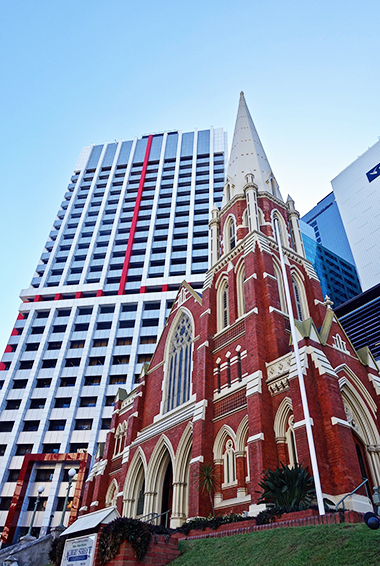 a church and skyscrapers in Brisbane