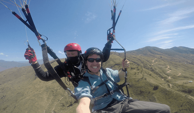 Backpacker doing adventure sports abroad