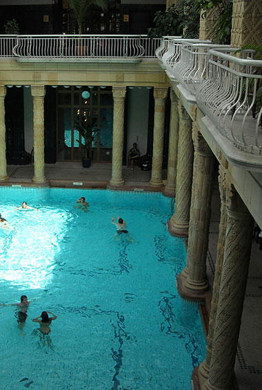 People bathing in the naturally heated hot spring baths in Budapest