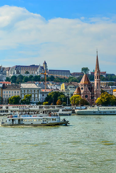 People enjoying a boat cruse along the Danube in Budapest.
