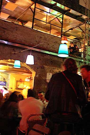 Photo by Daniel Edwins (flickr:@webmoof) People partying in one of Budapest's many Ruin pubs