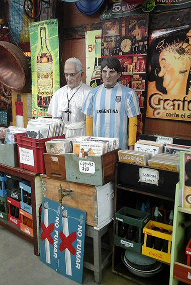 funny flea market wares at the San Telmo Market, including a statue of the pope