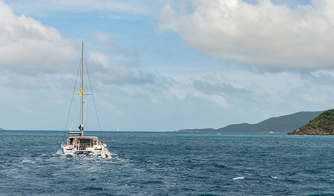 A boat sailing the British Virgin Islands at sunset