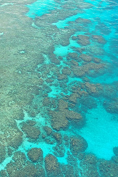 aerial view of the turquoise waters in the Great Barrier Reef