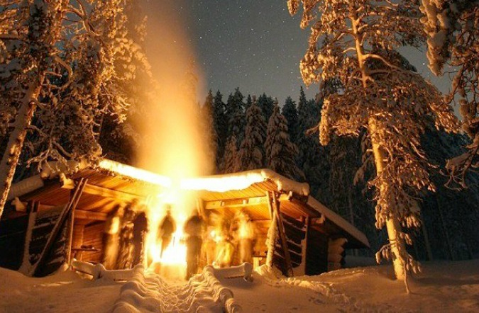 The camp fire in freezing temperatures and the stars of Finland by Laurence