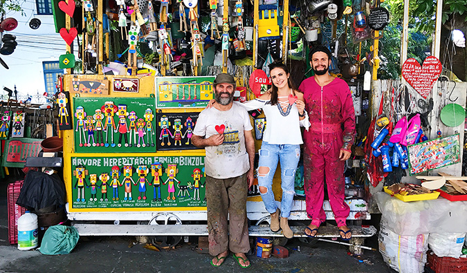 Celinne da Costa posing with some locals at their small souvenir stand