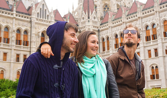 Celinne da Costa and two of her male Couchsurfing hosts posing for a photo in Europe