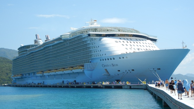 massive cruise ship in a harbor