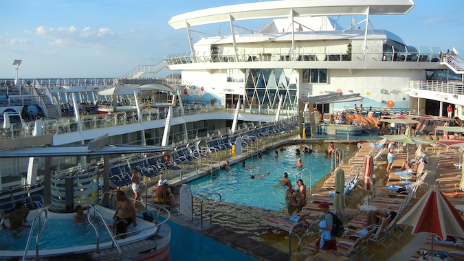 cruise deck filled with lots of passengers on vacation
