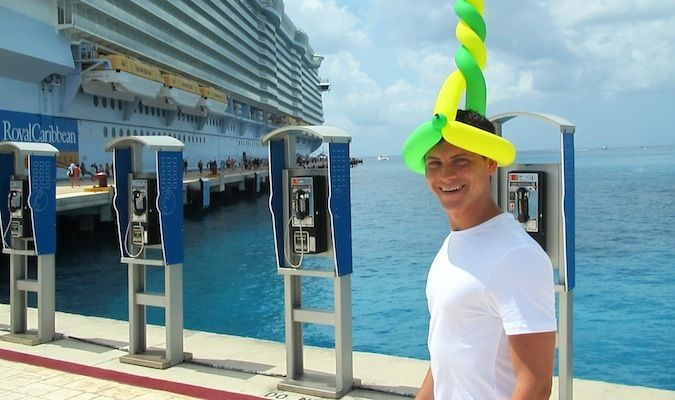 Nomadic Matt on a cruise in the caribbean with a funny balloon hat