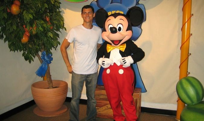 me and mickey mouse at a cheesy tourist activity in Disney world