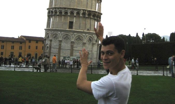Matt pretending to hold up the Leaning Tower of Pisa in Italy