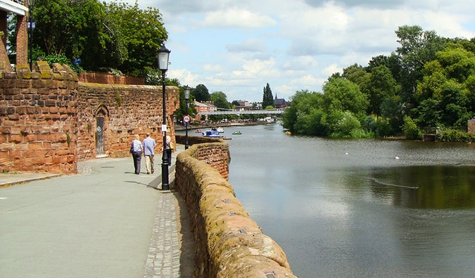 pedestrians walking along the city walls in Chester England; Photo by Sheri (Flickr: @bellatrix6)