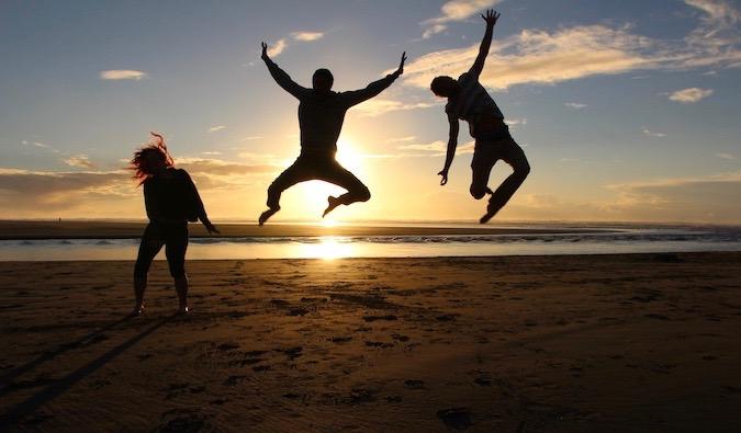 Vegan traveler Chris jumping during a sunset photo in California
