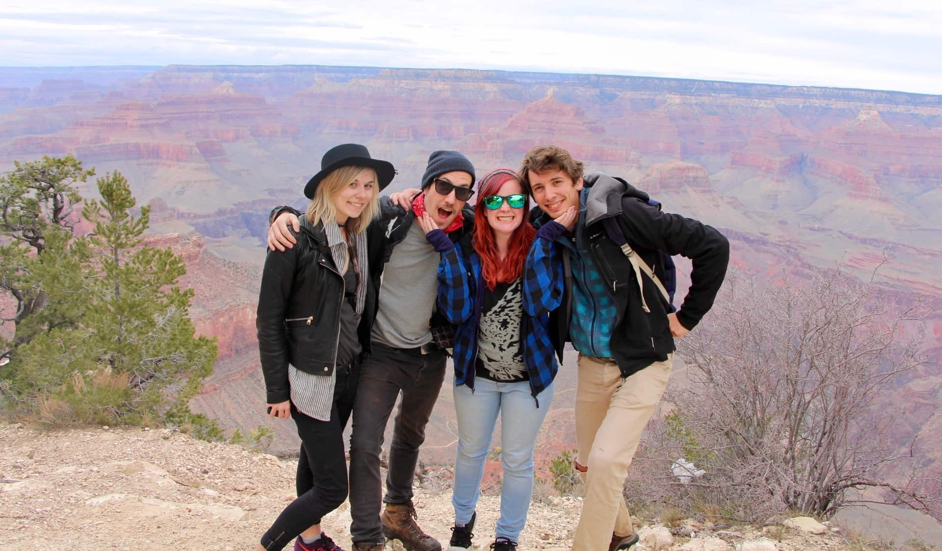 A group of travelers posing for a photo at the Grand Canyon in the USA