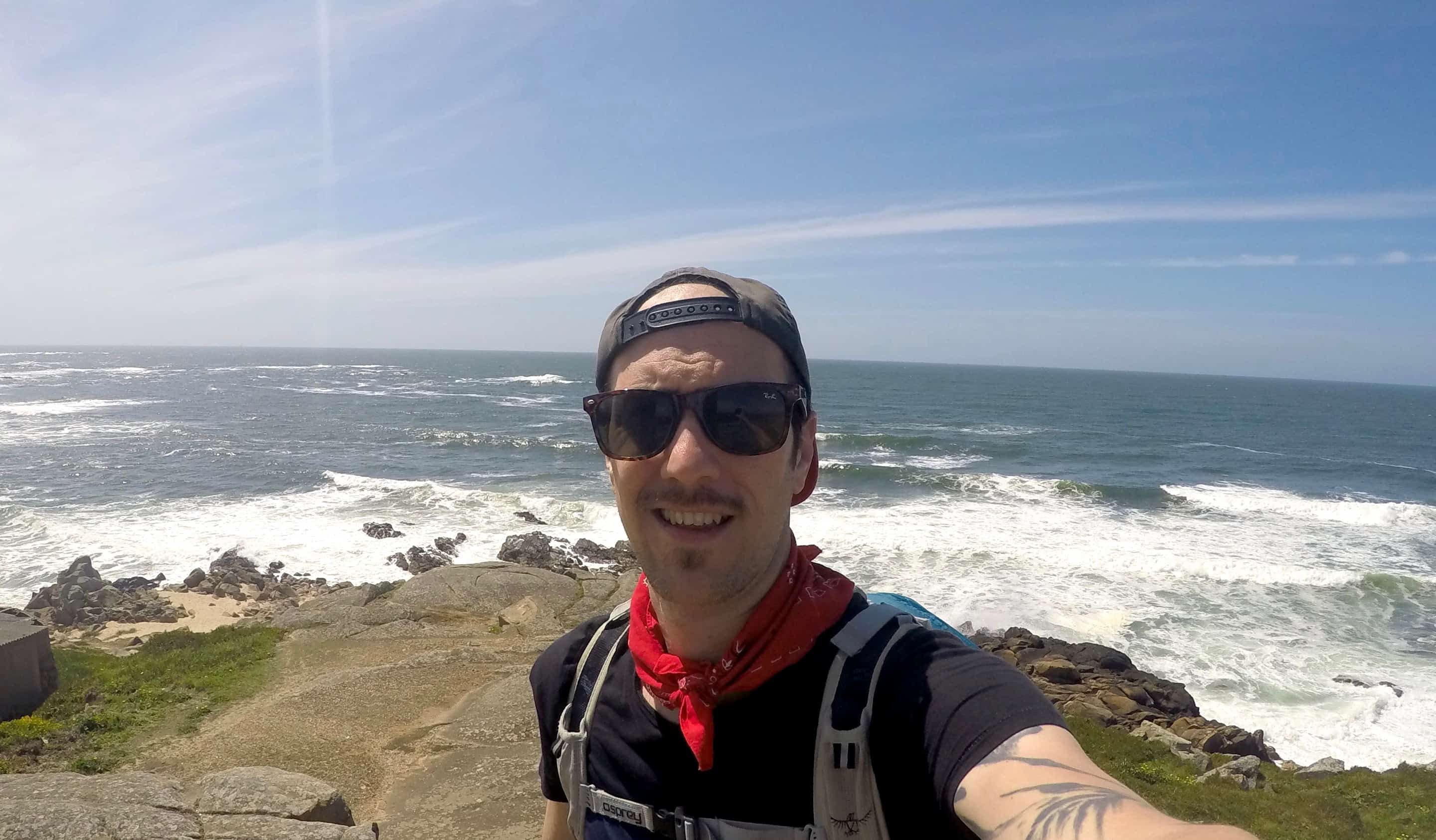 Chris Oldfield, a vegan traveler posing while on the Camino in Portugal
