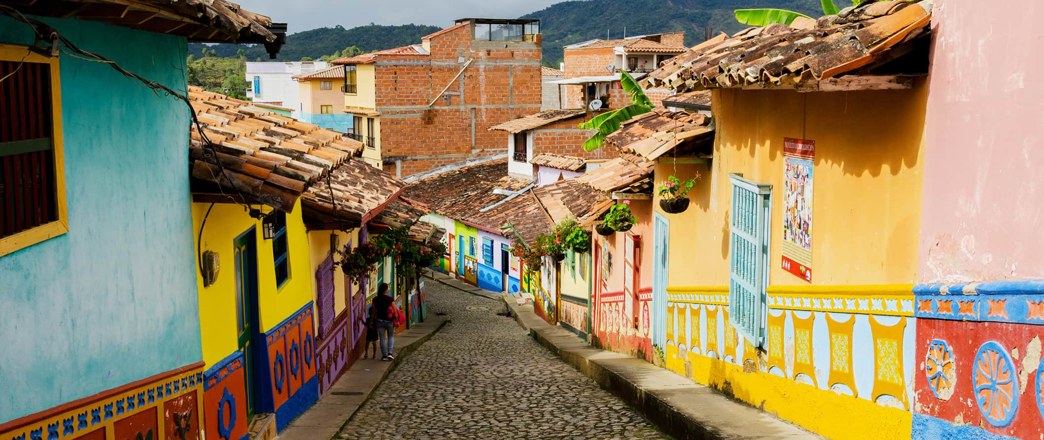 a colorful alleyway looking down a hill in Bogota, Colombia