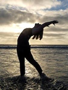 kristin addis doing yoga on a beach