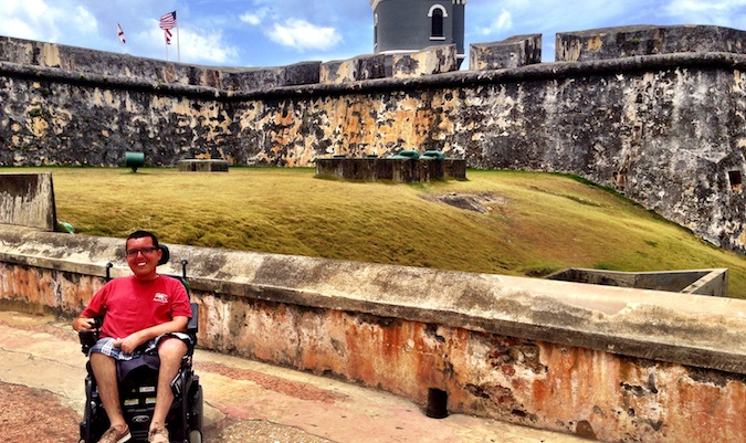 Cory Lee posing for a photo at an old historic fort