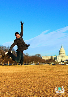 man jumping in a cold field while in his free time traveling