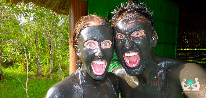 Boyfriend and girlfriend covered in mud overseas exploring the world together as a pair