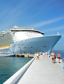 Giant mass tourism cruise parked in the harbor