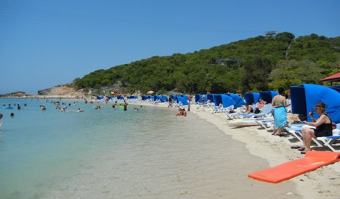 Packed beaches filled with people from the cruiseship