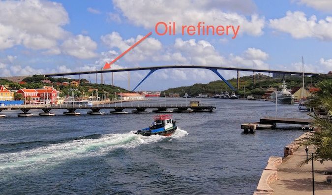 Willemstad's waterfront with an arrow pointing to the oil refinery in the Caribbean