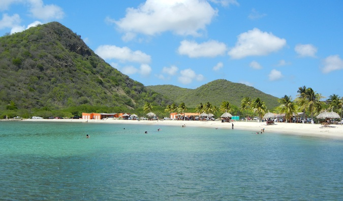 Beautiful Caribbean beaches with rolling hills behind them