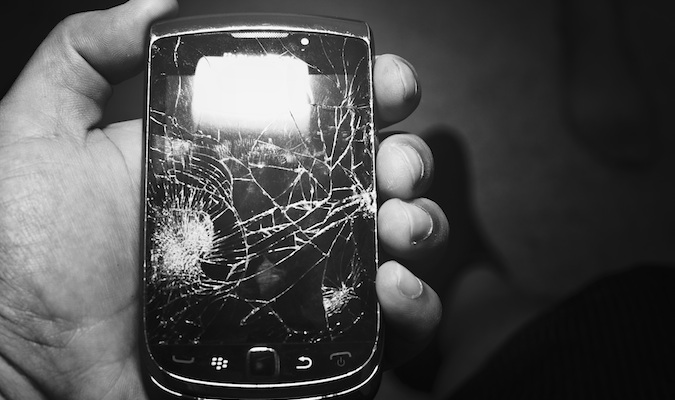 A black and white photo of a broke smartphone