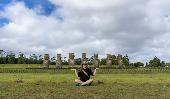 Solo traveler hiking through lush Easter Island