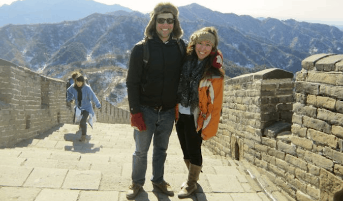 Two travelers posing together on the Great Wall in China
