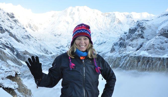 Erin from goeringo trekking in Nepal through snow-covered mountains