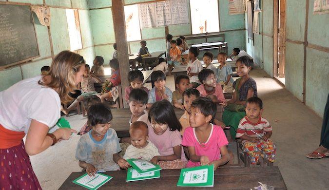 Erin from goeringo in burma teaching children in a small classroom