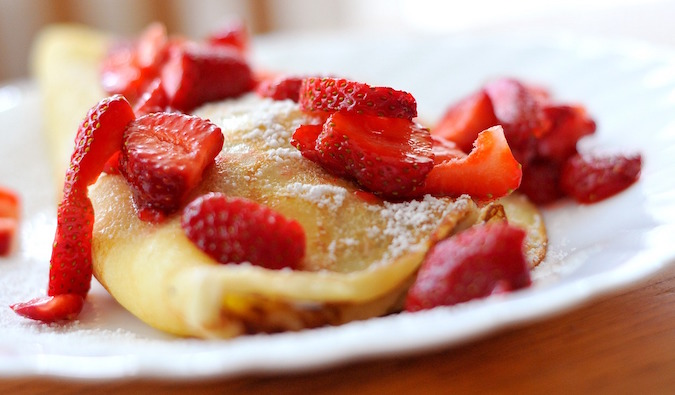 Sweet strawberry crepe with powdered sugar