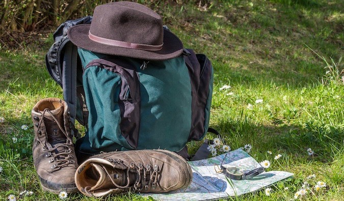 A bunch of hiking gear in an empty field
