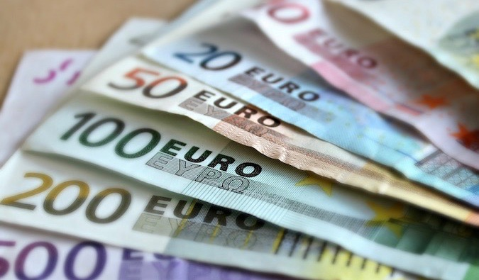 a bunch of colorful Euro bills