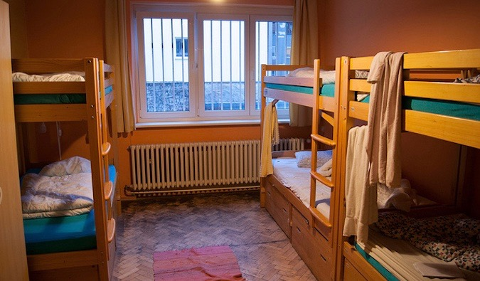 A set of bunk beds in a hostel dorm room