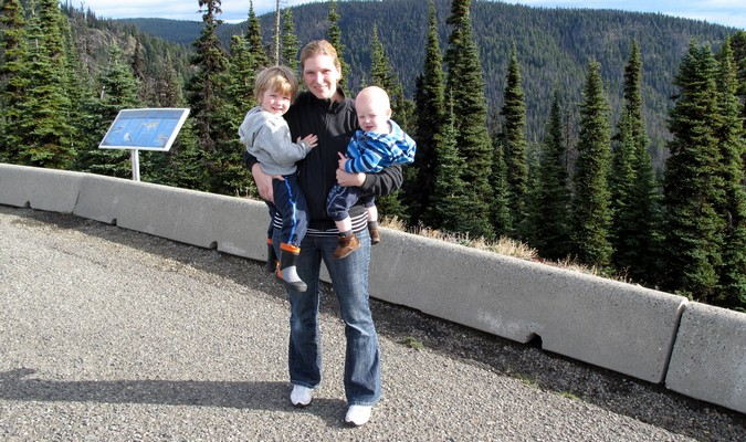 Mom holding her kids while traveling around Canada