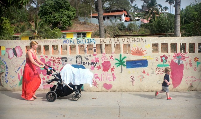 mom traveling in South America with toddler and baby stroller