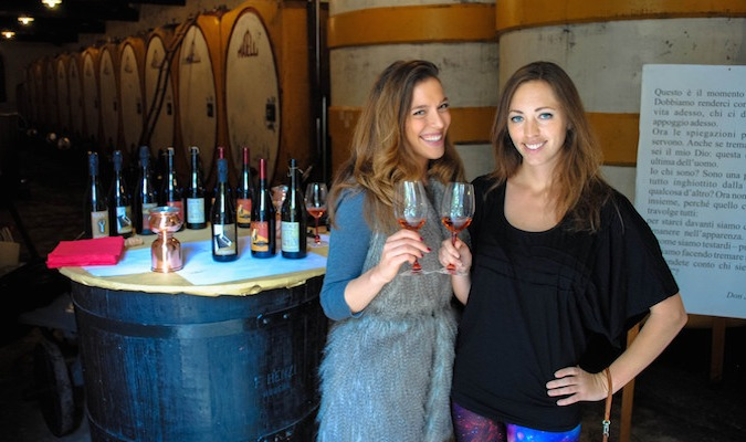 Solo female travelers dressed nicely at a winery abroad