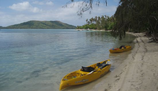Three kayaks lying on the beach in Fiji