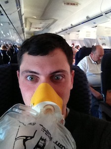 Nomadic Matt in an oxygen mask after the airplane depressurized