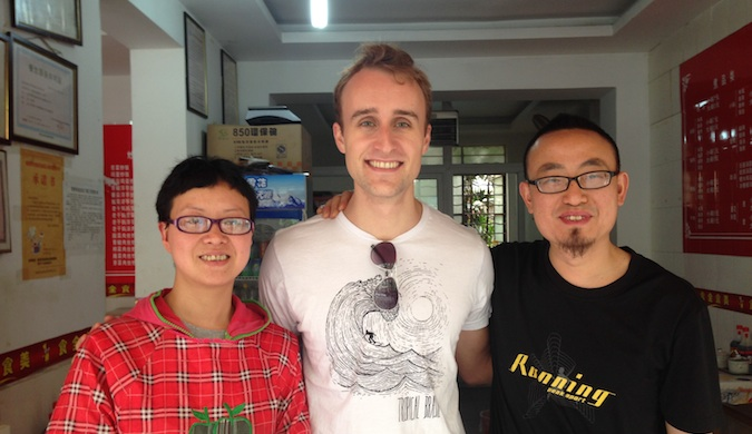 Scott with his homestay family in China, posing for a photo