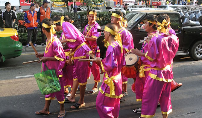 men dressed in pink performing in gay pride parade in bangkok
