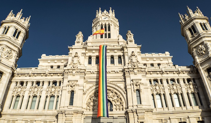 Gay LGBT pride flag hanging in Spain architecture
