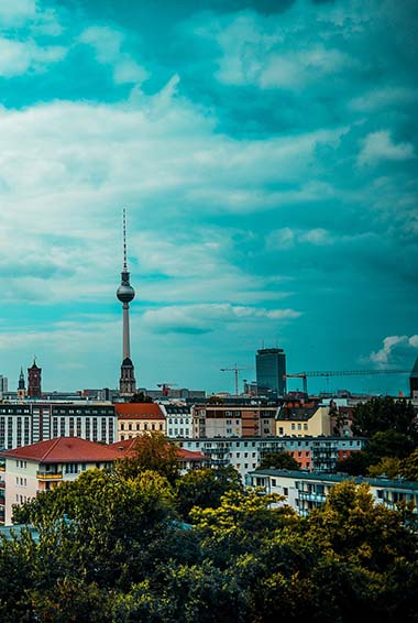 view over Berlin's rooftops with the radio tower in the distance